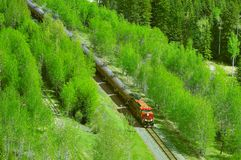 Freight train moves through Canadian Rockies. Freight train moves through Canadian Rockies to Vancouver royalty free stock photo