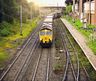 Freight train moves through the Trafford station. Stock Photography