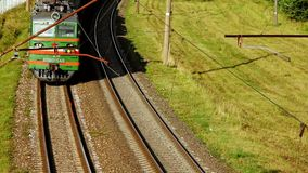 Freight train moving along rail road. Cargo train mowing on rail road tracks. Freight train moving along rail road. Industrial train passes on railway view from stock footage