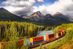 Train Moving in Mountains Stock Image