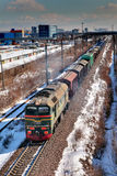 Freight train moving by rail, Russia, winter. Stock Image