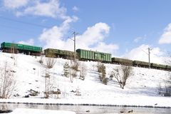 Freight train moving by railways in winter Royalty Free Stock Image