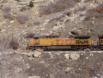 Freight train in narrow canyon Stock Images