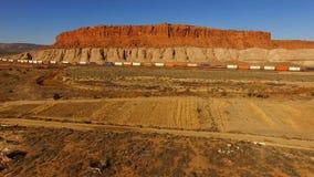Freight Train New Mexico Settlement Desert Landscape Rocky Butte stock video