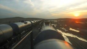 Freight train oil tankers. Against Sunrise. 3d rendering. Freight train oil tankers. Against Sunrise. 3d rendering royalty free illustration
