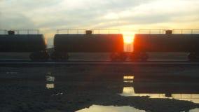 Freight train oil tankers. Against Sunrise. 3d rendering. Freight train oil tankers. Against Sunrise. 3d rendering vector illustration