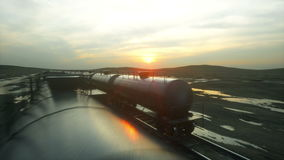 Freight train oil tankers. Against Sunrise. Realistic cinematic 4k animation. Freight train oil tankers. Against Sunrise. Realistic cinematic 4k animation stock video