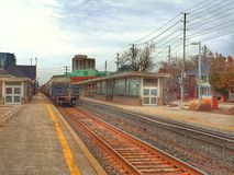 Freight Train Passing Brampton GO Station. A freight train passes by the Brampton, Ontario, Canada GO/VIA station on its way east to Toronto from points west stock photography