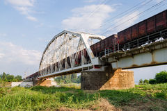 Freight train passes over the bridge Stock Photography