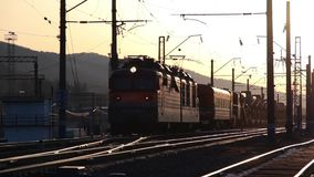 Freight Train Passes By Railway At Sunset, Trans-Siberian Railway stock video footage