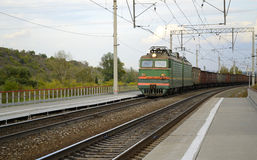 Freight train passes through the station. Stock Image
