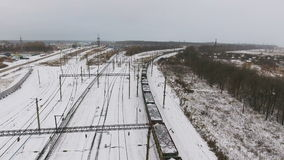 Freight train passing. Bird view. Freight train passing. Aerial view stock footage