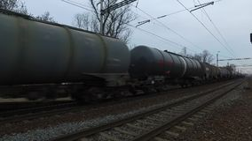 Freight train is passing through the country. Durign cloudy day. Audio is included. Using of camera slider stock footage