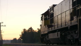 Freight train passing by in the countryside. stock video footage