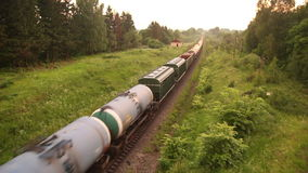 Freight train_01. Freight train passing the forest, top view stock video footage