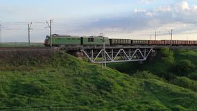 Freight train passing over the railway bridge in countryside. Trans-siberian railway stock video footage