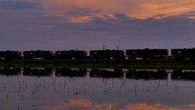 Freight train passing over water. Freight train passing over water in countryside of Thailand. silhouette background stock video