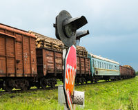 Freight train passing the railroad crossing Royalty Free Stock Photo