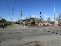 Freight train passing railroad crossing in West Haverstraw, NY. Stock Image