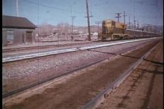 Freight train passing through railway station stock footage