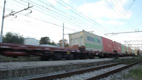Freight Train is Passing in a Station. From a Station of Pisa San Rossore stock footage