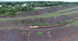 Freight train passing by underneath. And heading away in the far distance stock footage