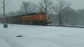 Freight train in snowstorm in Williamsport Indiana stock photos