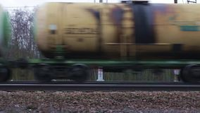 Freight train with petroleum tank. Railway carriages with oil Loop ready File stock video footage