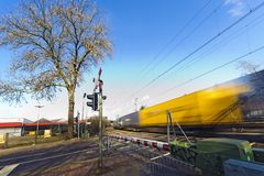 Freight train at a railroad crossing Stock Photo