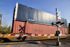 Freight Train. At a railroad crossing in Western New York. Image shows train cars, as they roll past the photographer stock photo