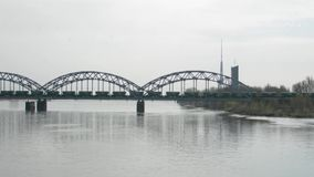 Freight train crossing railway bridge. Freight train on railway bridge stock video footage
