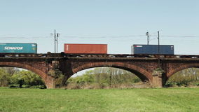 Freight train on railway bridge. Hochheim, Germany - April 20, 2015: A german freight train crosses a railway bridge between Mainz and Ginsheim one day before stock video footage