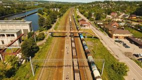 Freight train on the railway. Freight train with cisterns and containers on the railway. Aerial view Container Freight Train, Locomotive to the railway station stock video footage