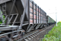 Freight train, railway wagons with motion blur effect. Transportation, railroad. Royalty Free Stock Images