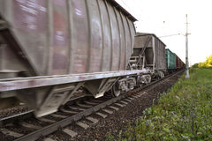 Freight train, railway wagons with motion blur effect. Transportation, railroad. Stock Photos
