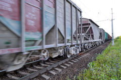 Freight train, railway wagons with motion blur effect. Transportation, railroad. Stock Images