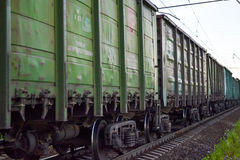 Freight train, railway wagons with motion blur effect. Transportation, railroad. Royalty Free Stock Photography