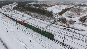 Freight train on the railway in winter. Gasoline, fuel tanks. Aerial shot. stock video