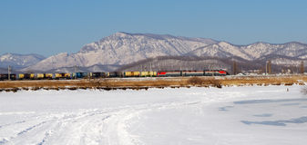 Freight train rides on a background of mountains Stock Photos