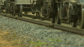 Freight train rides by rail. Transports laden wagons stock footage