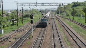 Lviv, Ukraine - May 2018: A freight train rides the railway station. A freight train rides the railway station stock video footage