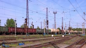 Freight train rides on railway in summer day. Against blue sky stock footage