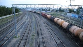 Freight train rides under the bridge, top view. Railway stock video footage