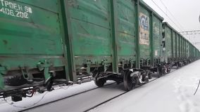 Freight train rides at winter time. Freight train rides in winter time stock video