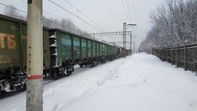 Freight train rides at winter time. Freight train rides in winter time stock footage