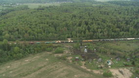 Freight Train rides through the woods, the fields.  stock footage