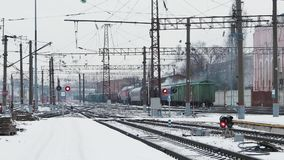 Freight train running on the railway tracks at winter. Back view of a freight train running on the railway tracks at winter stock footage