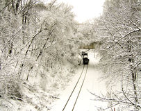Freight train on snowed tracks Royalty Free Stock Photography