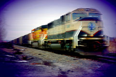 Freight train speeding by Royalty Free Stock Photos