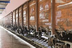 Freight train at the station Stock Photos